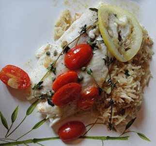 Pangasius with cherry tomatoes and garlic